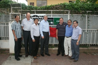 Touch Chiva (LAC), Denzil Sprague (CRI), Kimleng Ouk (LAC), Frank Meredith (CRI), Bill Jackson (CRI), Run Saray (LAC) and Op Vibol (LAC) at the opening of CRI's new Cambodian office.